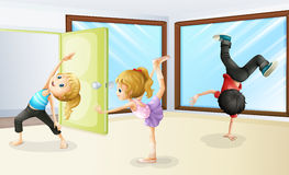 Three kids stretching and dancing. Illustration Stock Images