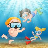 Three kids swimming and diving underwater Royalty Free Stock Photo
