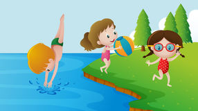 Three kids swimming in the lake Stock Images