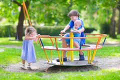 Three kids on a swing Stock Images