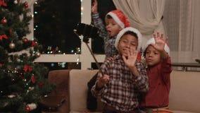 Three kids take Christmas selfie. stock video footage