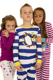 Three kids wearing winter pajamas two girls afraid Stock Image