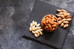 Three kind of almond: in shell, natural and peeled nut. Healthy. Food concept top view with place for text Stock Images