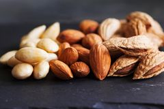 Three kind of almond: in shell, natural and peeled nut. Healthy. Food concept close up Royalty Free Stock Photo