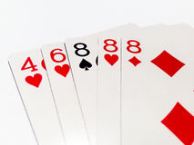 Three of Kind Card in Poker Game with White Background. A playing card is a piece of specially prepared heavy paper, thin cardboard, plastic-coated paper, cotton Stock Photography