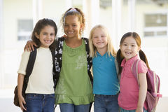 Three kindergarten girls standing together Royalty Free Stock Photos