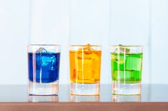 Three kinds of alcoholic drinks in shot glasses on Royalty Free Stock Photography