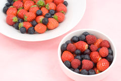 Three kinds of berry. On the plate Royalty Free Stock Photos