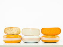 Three kinds of cheese arranged in line Royalty Free Stock Photos