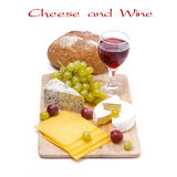 Three kinds of cheese, bread, grapes and wine, isolated Stock Photography