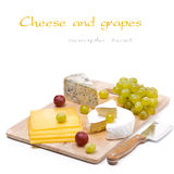 Three kinds of cheese and grapes, isolated Royalty Free Stock Photo