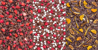 Three kinds of chocolate bars with dried berries, fruit and nuts. Three kinds of chocolate bars with dried berries, fruit, and nuts. Could be used as backgrounds Royalty Free Stock Image