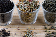 Three kinds of dry tea in glasses Royalty Free Stock Photos