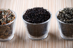 Three kinds of dry tea in glasses Royalty Free Stock Photography