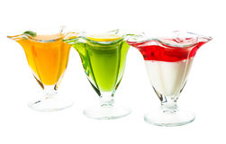 Three kinds of of jelly. In glass the cups stock image