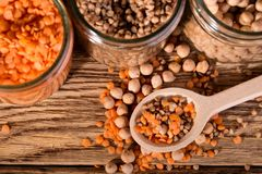 Three kinds of legumes on wooden spoon Royalty Free Stock Photos