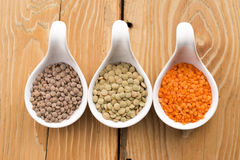 Three kinds of lentil in bowls Stock Images