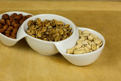 Three kinds of nuts in a dish Royalty Free Stock Photography