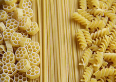 Three Kinds of Pasta. Three types of uncooked (raw) pasta (macaroni): spaghetti, fusilli and fiori Royalty Free Stock Photography