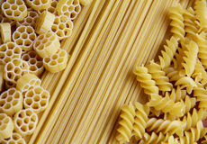 Three Kinds of Pasta. Three types of uncooked (raw) pasta (macaroni): spaghetti, fusilli and fiori Stock Photography