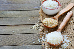 Three kinds of raw rice on wooden spoon Royalty Free Stock Image