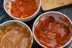Three Kinds of Red Tomato Sauce in White Ceramic Bowls at the Restaurant Kitchen, Barbecue Sauce, Sweet and sour Chinese sauce. To. Three Kinds of Red Tomato Royalty Free Stock Photos