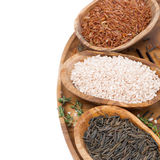 Three kinds of rice and thyme in a wooden bowl, top view Stock Image