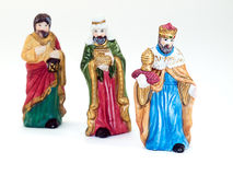 Three kings. Figurines of a three Kings isolated on a clear background Royalty Free Stock Photos