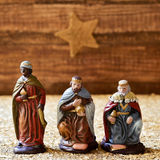 The three kings. Closeup of the three kings carrying their gifts, and the christmas star in the background, on a rustic scene Royalty Free Stock Image