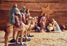 The three kings and the holy family. The three kings on their camels and the holy family in a rustic nativity scene Royalty Free Stock Photo
