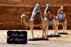 Three kings and text feliz dia de reyes, happy epiphany in spani. A black label with the text feliz dia de reyes, happy epiphany in spanish, and the three kings Royalty Free Stock Photo