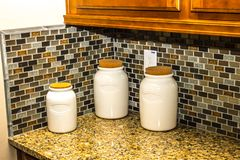 Three Kitchen Ceramic Containers. On Modern Kitchen Counter Stock Images