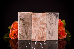 Three kitchen countertop samples made of granite, marble and quartz stone Stock Images