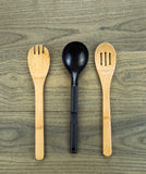 Three kitchen spoons on aged white oak wood Stock Image