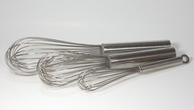 Three kitchen wire whisks Royalty Free Stock Photography