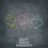 Three kites illustration on chalkboard of happy makar sankranti Royalty Free Stock Image