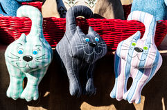 Three kittens of various colors of fabric stock photography