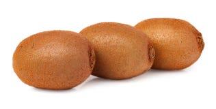 Three kiwi fruit on white isolated background Stock Image