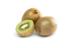 Three Kiwis. Standing, lying and cut in half. on white background royalty free stock photos