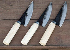 Three knife on wooden plate. Three knife arranged on wooden plate Stock Image