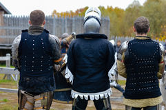 Three knights standing together before battle Stock Photo