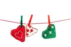 Three knitted hearts Stock Photos