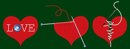 Three knitted red heart. Knitted heart on a green background Royalty Free Stock Photo