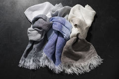 Three Knotted Fringed Hand Towels of Various Colors Stock Images