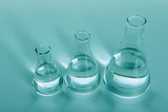 Three laboratory Flasks Viewed from Above Stock Photography