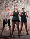 Three Ladies in Boot Camp Workout Royalty Free Stock Images