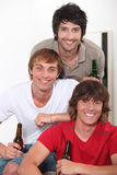 Three lads with beer Stock Image