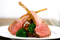 Three Lamb chops herb crusted Stock Photo