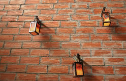 Three lamps. On a brick wall royalty free stock image