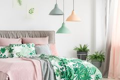 Three lamps above bed Stock Image